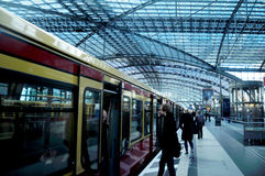 German people walking up and down train inside of Berlin Hauptbahnhof Railway Central Station Stock Images