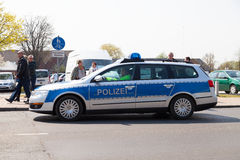 German police car drives on a street Royalty Free Stock Photo
