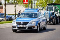 German police car drives on a street. ALTENTREPTOW / GERMANY - MAY 1, 2018: German police car drives on a street during an Oldtimer Show royalty free stock photography