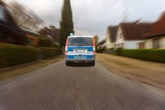 German police car driving on a road. Polizei is the German word for police royalty free stock photography