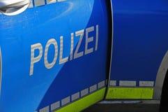 Open door of german police car. German police car on the job with open door royalty free stock photo