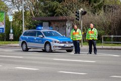 German police car with two policeman stands on a street. ALTENTREPTOW / GERMANY - MAY 1, 2018: German police car with two policeman stands on a street royalty free stock photography