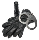 German police handcuffs, leather gloves and a torchlight isolated on white background. royalty free stock photo
