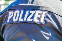 German police man with the blue jacket Royalty Free Stock Photography