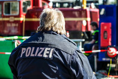 German police man with the blue jacket Royalty Free Stock Image