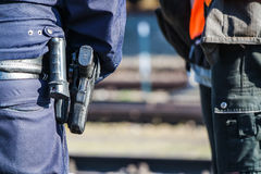 German police man with gun. German police man with the blue jacket and gun Stock Photo