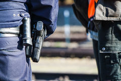 German police man with gun. German police man with the blue jacket and gun Royalty Free Stock Photo