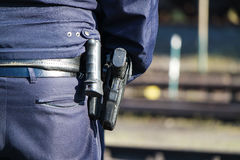 German police man with gun. German police man with the blue jacket and gun Stock Image