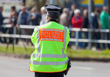 German police officer stands on street. A german police officer stands on street Stock Image