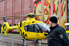 German policeman protects ADAC rescue helicopter Stock Photos