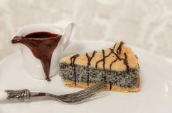German poppy seed cake on white plate Stock Photos