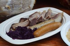 German Pork Hock and Sausage. Note select focus with shallow depth of field stock image
