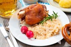 German Pork Knuckle. Schweinshaxe (German Pork Knuckle) with pickled cabbage Stock Images