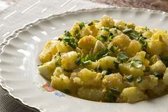 German potato salad with fresh dill in white bowl Royalty Free Stock Image