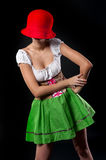 German pretty girl covers by hat Stock Photography