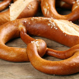 German Pretzel on a wooden table Stock Image