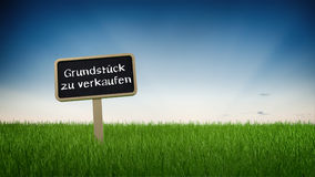 German Private Property Sale Sign on Green Lawn. Digitally Generated Graphic of Sign Posted in Long Green Grass in front of Blue Sky with Rising or Setting Sun Royalty Free Stock Photos