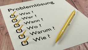 German problem solving checklist ballpen and tick marks. Problem solving checklist in german with the words what who when where why and how on a piece of paper Stock Photo