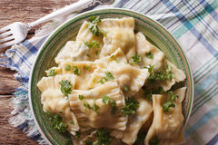German ravioli Maultaschen with spinach and meat close up. Horizontal top view stock image