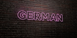 GERMAN -Realistic Neon Sign on Brick Wall background - 3D rendered royalty free stock image Royalty Free Stock Images