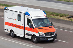 German Red Cross Rescue Service Car. FRANKFURT, GERMANY - JULY 26: German Red Cross Rescue Service Mercedes Benz Sprinter moving fast on the highway A5 near Royalty Free Stock Photography