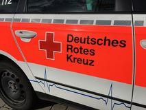 German Red Cross. Red Cross sign on the side of an ambulance Royalty Free Stock Images