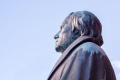 German reformer Martin Luther. Statue at Lutherkirken in Copenhagen, profile against bly sky Stock Photos