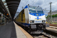 German regional express RE train from Metronom, arrives at hamburg train station in june 2014. HAMBURG, GERMANY - JUNE 2014: German regional express RE train stock illustration