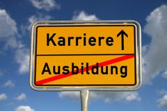 German road sign apprenticeship and career. With blue sky and white clouds stock image