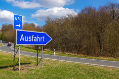 German road sign: signpost at junction, translation: exit royalty free stock photography