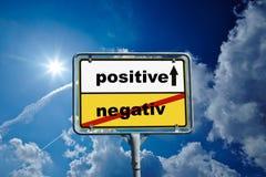 German roadsign positive / negative blue sky stock photo