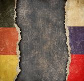 German and Russian torn paper flags. Break of diplomatic relations. Stock Photo