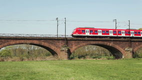 German S-Bahn. A German S-Bahn crosses a railway bridge between Mainz and Ginsheim stock video