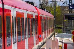 German S-bahn train arriving to the train stop, Munich Stock Photo