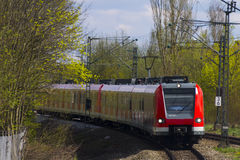 German S-bahn train arriving to the train stop, Munich Royalty Free Stock Images