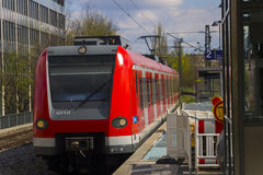 German S-bahn train arriving to the train stop, Munich Stock Photos