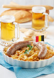 German sausage and cabbage. Traditional german dish with cabbage and sausage, selective focus Royalty Free Stock Photography