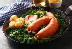 German Sausage, Pork and Potatoes on Veggies Top Royalty Free Stock Photography