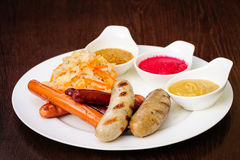 German sausages with cabbage Royalty Free Stock Photo