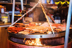 German sausages. The process of cooking over a fire. Stock Image