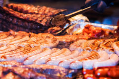 German sausages. The process of cooking over a fire. Royalty Free Stock Photos