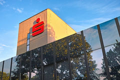 German Savings Bank Symbol. Giessen, Germany - June 24, 2013: Modern glass office building with red sign of German Sparkasse Network (German: Savings Bank) in Stock Photo