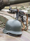 German Schmeisser submachine gun and helmet on the armor of the Stock Photography