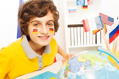 German schoolboy learning geography at the class Stock Photo