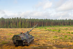 German self-propelled howitzer on battlefield Royalty Free Stock Image