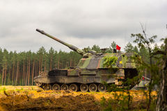 German self-propelled howitzer on battlefield Stock Photos