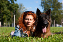 German shepherd with girl Stock Image