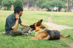 German Shepherd and men Royalty Free Stock Photos