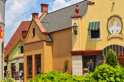 German shops. FRANKENMUTH, MI - JUNE 28, 2014: German-style architecture forms the backdrop of River Place, a recently established collection of shops and Royalty Free Stock Images