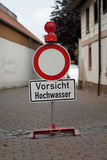 German sign that says caution flood Stock Images